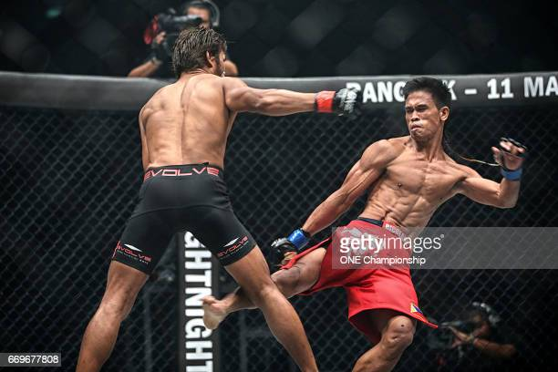 Ramon Gonzales throws a kick at the leg of Yodsanan Sityodtong during the ONE Championship: Warrior Kingdom event at the Impact Arena on March 11,...
