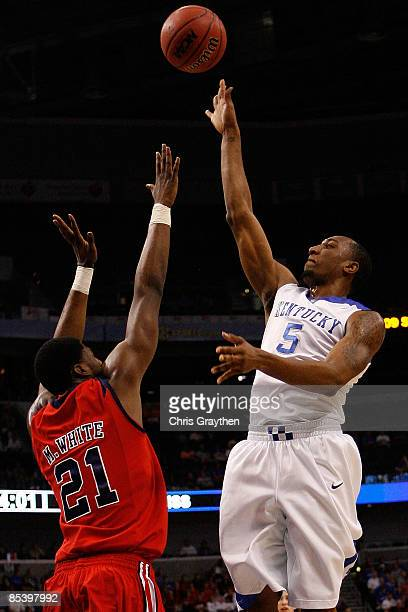 Ramon Harris of the Kentucky Wildcats makes a shot over Malcom White of The Ole Miss Rebels during the first round of the SEC Men's Basketball...