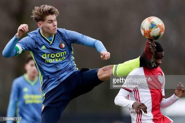 Ramon Hendriks of Feyenoord U19 Arjany Martha of Ajax U19 during the match between Ajax U19 v Feyenoord U19 at the De Toekomst on February 15 2020 in...