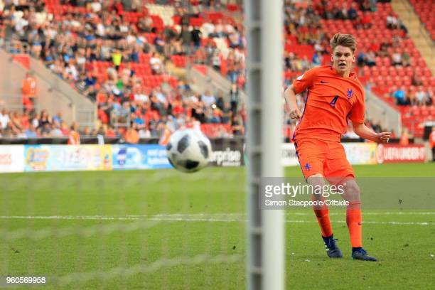 Ramon Hendriks of Netherlands scores the winning penalty in the shootout during the UEFA European Under17 Championship Final match between Italy and...
