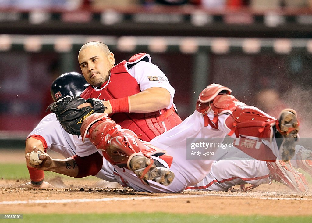 Ramon Hernandez #55 of the Cincinnati Reds holds on to the ball after tagging out Skip Schumaker #55 of the St. Louis Cardinals to end the Gillette Civil Rights Game at Great American Ball Park on May 15, 2010 in Cincinnati, Ohio. The Reds won 4-3.