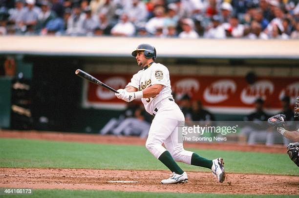 Ramon Hernandez of the Oakland Athletics bats during the game against the Chicago White Sox on August 30 2000 at Network Associates Coliseum in...