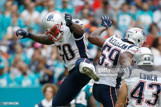 Ramon Humber and Albert McClellan of the New England Patriots celebrate a touchdown against the Miami Dolphins at Hard Rock Stadium on December 9...