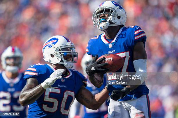 Ramon Humber congratulates Tre'Davious White of the Buffalo Bills for an interception White made during the second half against the Denver Broncos on...