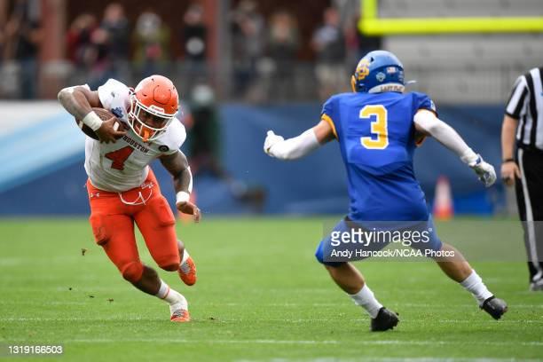 Ramon Jefferson of the Sam Houston State Bearkats evades Joshua Manchigiah of the South Dakota State Jackrabbits during the Division I FCS Football...
