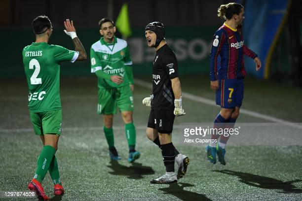 Ramon Juan Ramirez of Cornella celebrates with team mate Albert Manel Estelles Fernandez after saving a penalty taken by Ousmane Dembele of Barcelona...