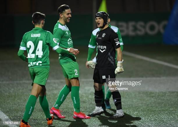 Ramon Juan Ramirez of Cornella celebrates with team mates Gerard Martin Langreo and Albert Manel Estelles Fernandez after saving a penalty taken by...