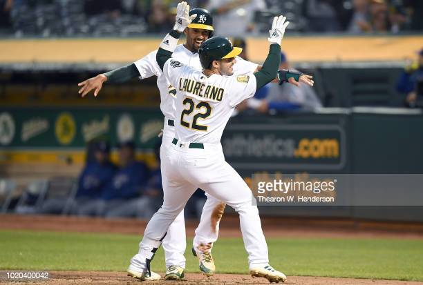 Ramon Laureano and Marcus Semien of the Oakland Athletics celebrates after Laureano hit a two-run home run against the Texas Rangers in the bottom of...