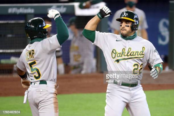 Ramon Laureano celebrates with Tony Kemp of the Oakland Athletics after hitting a three-run home run in the fifth inning against the Seattle Mariners...