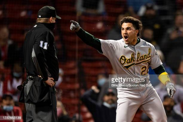 Ramon Laureano of the Oakland Athletics argues with home plate umpire Tony Randazzo as he is ejected from the game during the third inning of a game...