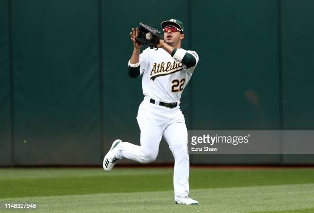 Ramon Laureano of the Oakland Athletics catches a ball against the Cincinnati Reds at Oakland-Alameda County Coliseum on May 09, 2019 in Oakland,...