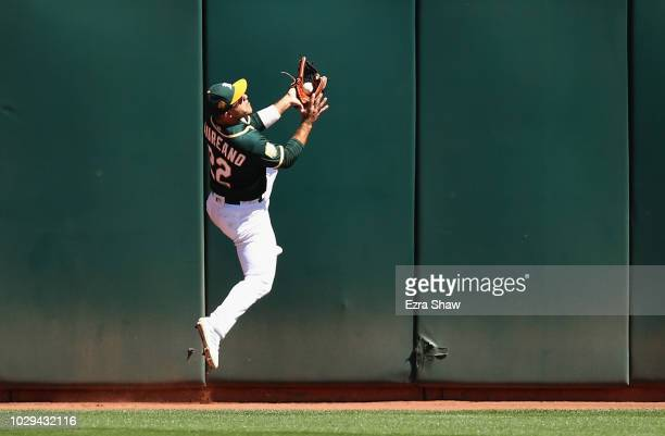 Ramon Laureano of the Oakland Athletics catches a ball hit by Adrian Beltre of the Texas Rangers in the third inning at Oakland Alameda Coliseum on...