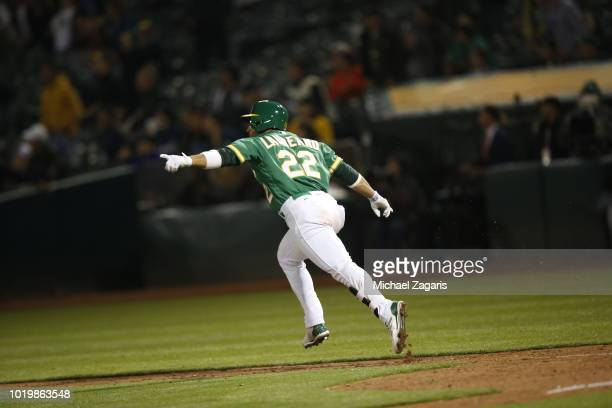 Ramon Laureano of the Oakland Athletics celebrates on his way to first after hitting a walkoff single during the game against the Detroit Tigers at...