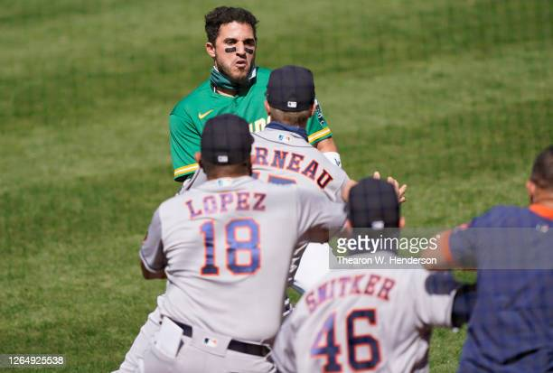 Ramon Laureano of the Oakland Athletics charges towards the Houston Astros dugout after he was hit by a pitch in the bottom of the seventh inning at...