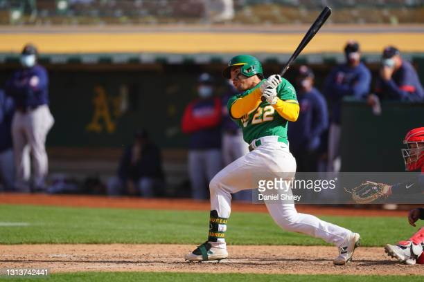 Ramon Laureano of the Oakland Athletics drives in a run by reaching first on an error during the tenth inning against the Minnesota Twins at...