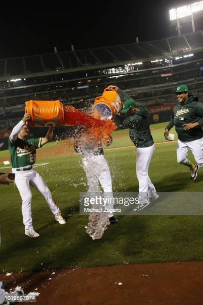 Ramon Laureano of the Oakland Athletics gets a Gatorade bath after hitting a walkoff single following the game against the Detroit Tigers at the...