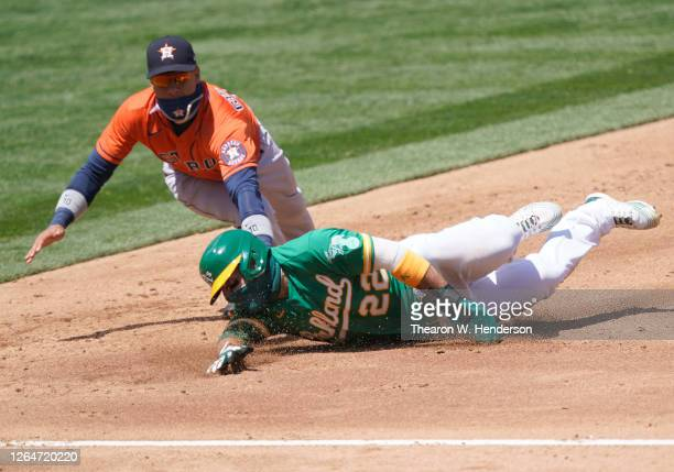 Ramon Laureano of the Oakland Athletics gets caught in a rundown and tagged out by Yuli Gurriel of the Houston Astros in the bottom of the third...
