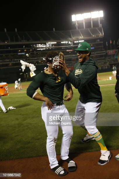 Ramon Laureano of the Oakland Athletics gets pied by Sean Manaea after hitting a walkoff single following the game against the Detroit Tigers at the...