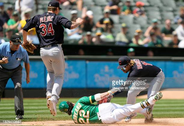Ramon Laureano of the Oakland Athletics gets tagged out at third base by Jose Ramirez of the Cleveland Indians in the bottom of the fifth inning at...