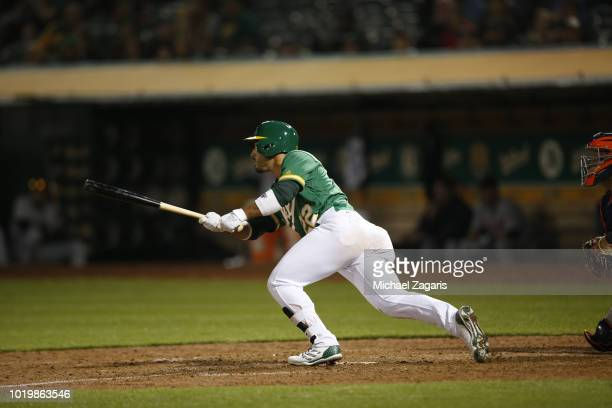 Ramon Laureano of the Oakland Athletics hits a walkoff single during the game against the Detroit Tigers at the Oakland Alameda Coliseum on August 3...