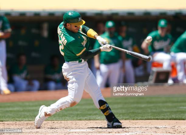 Ramon Laureano of the Oakland Athletics hits an RBI single in the bottom of the fourth inning against the Seattle Mariners at RingCentral Coliseum on...