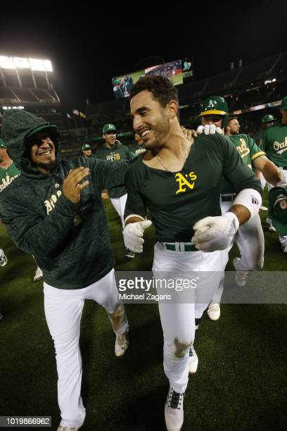 Ramon Laureano of the Oakland Athletics is congratulated by Franklin Barreto after hitting a walkoff single following the game against the Detroit...