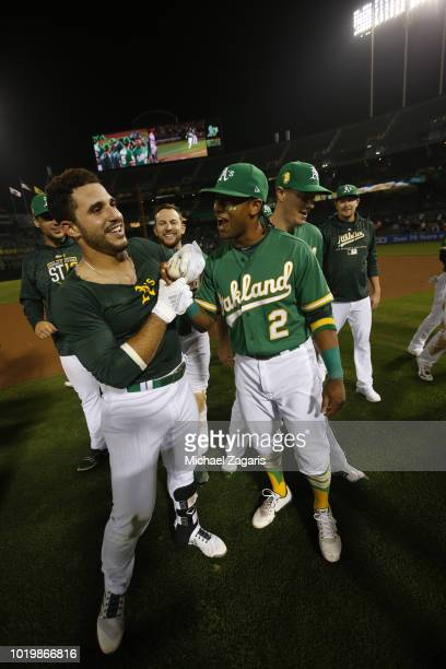 Ramon Laureano of the Oakland Athletics is congratulated by Khris Davis after hitting a walkoff single following the game against the Detroit Tigers...