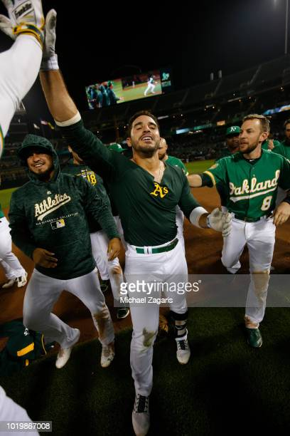 Ramon Laureano of the Oakland Athletics is congratulated by teammates after hitting a walkoff single following the game against the Detroit Tigers at...