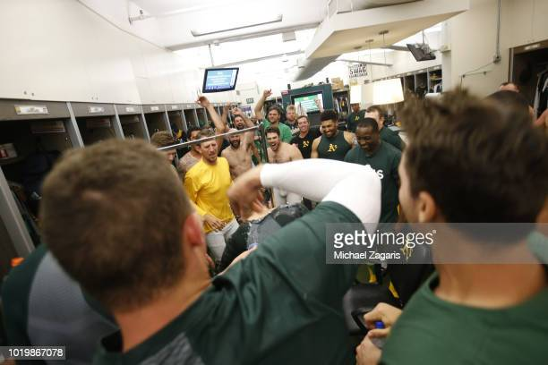 Ramon Laureano of the Oakland Athletics is congratulated by teammates in the clubhouse after hitting a walkoff single following the game against the...