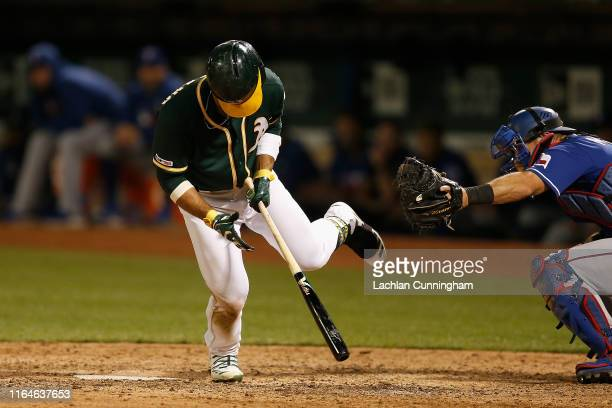 Ramon Laureano of the Oakland Athletics is hit by a pitch in the bottom of the eighth inning against the Texas Rangers at Ring Central Coliseum on...
