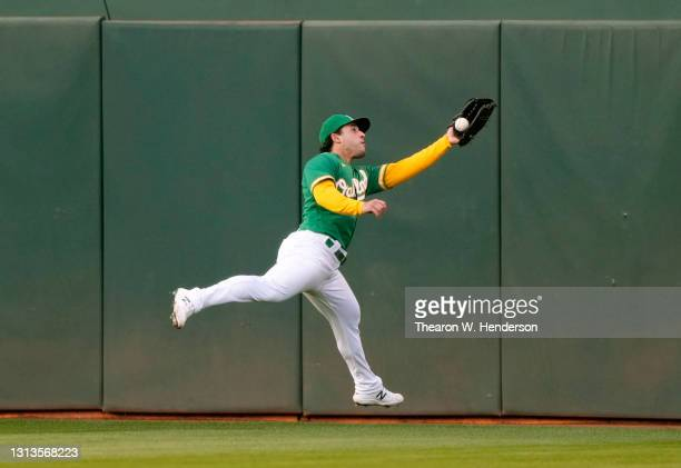 Ramon Laureano of the Oakland Athletics make a running catch taking a hit away from Mitch Garver of the Minnesota Twins in the fourth inning during...