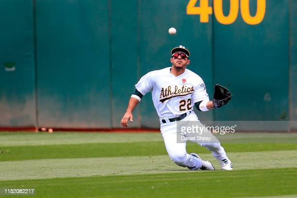 Ramon Laureano of the Oakland Athletics makes a diving catch during the second inning against the Los Angeles Angels at Oakland-Alameda County...