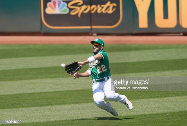 Ramon Laureano of the Oakland Athletics makes a sliding catch taking a hit away from Mike Trout of the Los Angeles Angels in the top of the fith...