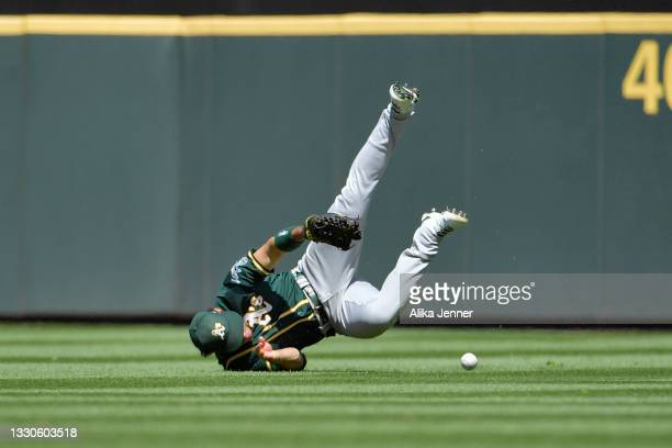 Ramon Laureano of the Oakland Athletics misses Tom Murphy's run scoring shallow single in the third inning at T-Mobile Park on July 25, 2021 in...