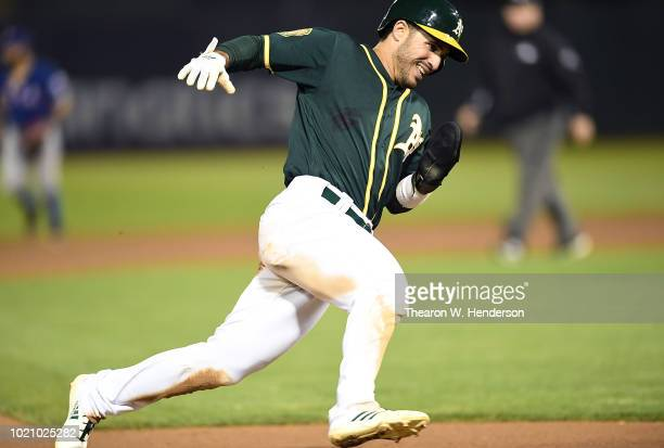 Ramon Laureano of the Oakland Athletics runs the bases to score against the Texas Rangers in the bottom of the six inning at Oakland Alameda Coliseum...
