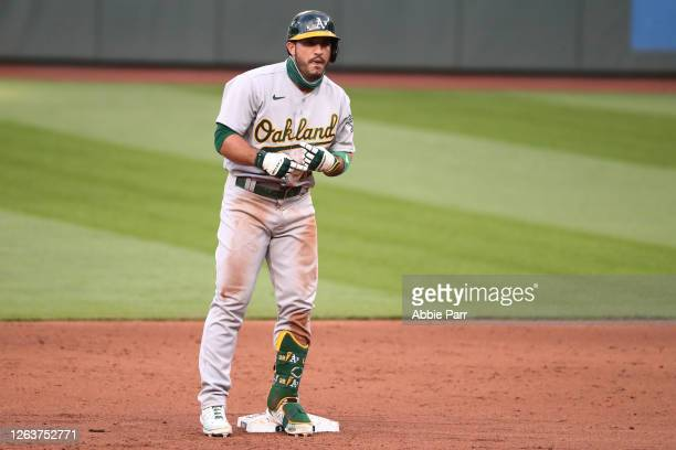 Ramon Laureano of the Oakland Athletics signals to teammates to celebrate hitting a two run single in the fifth inning to make the score 2-1 against...