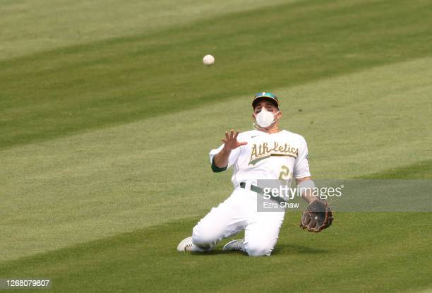 Ramon Laureano of the Oakland Athletics slides but can not catch a ball hit by Mike Trout of the Los Angeles Angels in the third inning at...