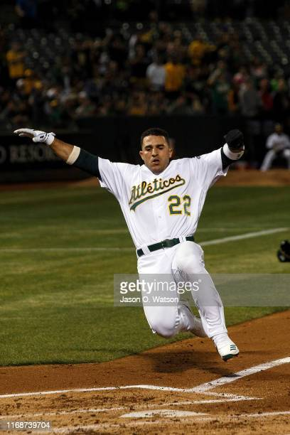 Ramon Laureano of the Oakland Athletics slides into home plate to score a run against the Kansas City Royals during the first inning at the...