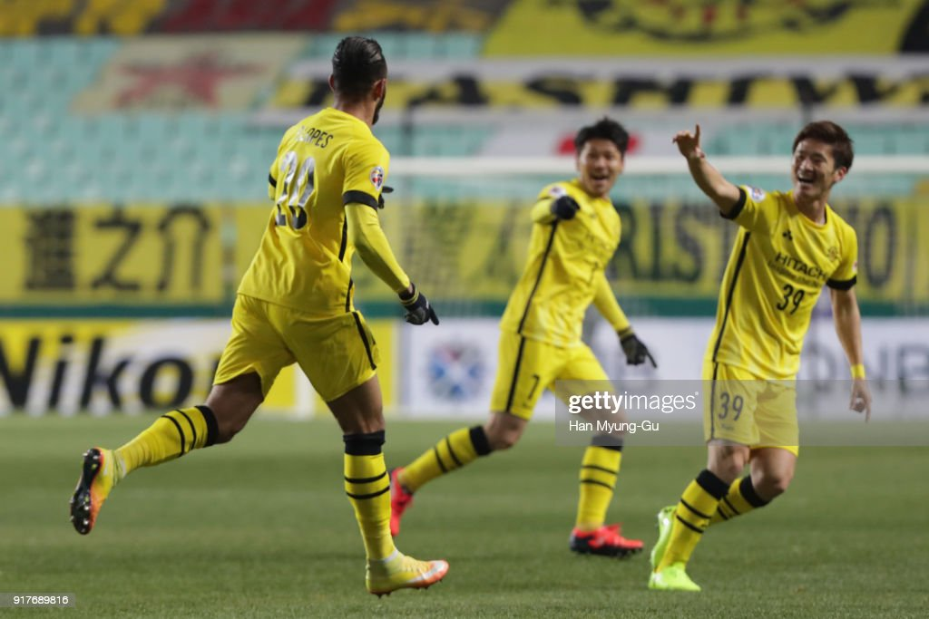 Ramon Lopes (L) of Kashiwa Reysol celebrates scoring the opening goal during the AFC Champions League Group E match between Jeonbuk Hyundai Motors and Kashiwa Reysol at the Jeonju World Cup Stadium on February 13, 2018 in Jeonju, South Korea.