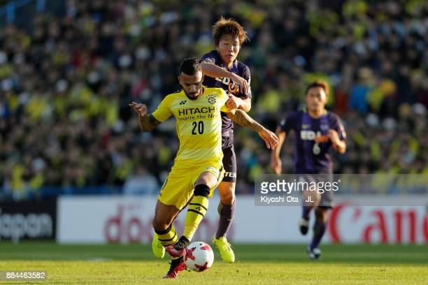 Ramon Lopes of Kashiwa Reysol controls the ball under pressure of Sho Inagaki of Sanfrecce Hiroshima during the JLeague J1 match between Kashiwa...