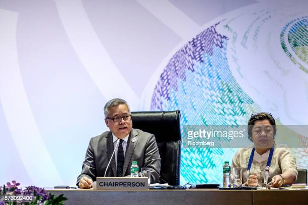 Ramon Lopez the Philippines' secretary of trade and industry left speaks during the Asean economic council meeting at the Association of Southeast...