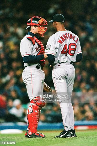 Ramon Martinez and Jason Varitek of the Boston Red Sox talk on the mound during Game Two of the American League Championship Series against the New...