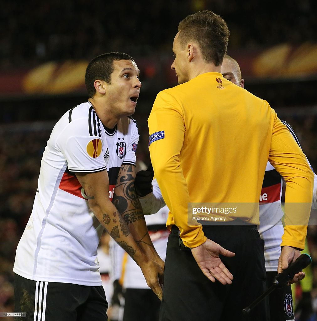 Ramon Motta of Besiktas (L) reacts during the UEFA Europa League Round of 32 match between Liverpool and Besiktas at Anfield Stadium in Liverpool on February 19 2015.