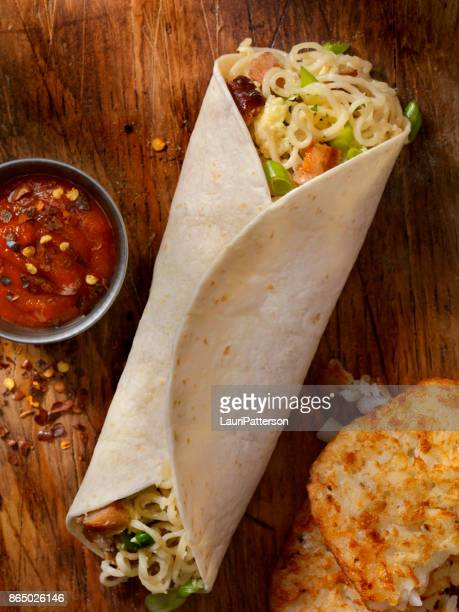 ramon noodle, egg and sausage breakfast burrito - burrito stock pictures, royalty-free photos & images