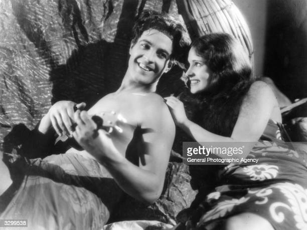 Ramon Novarro and Dorothy Janis in a scene from 'The Pagan', a tropical romance filmed in the South Seas. The film was directed by W S Van Dyke for...