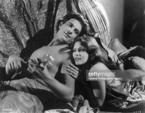 Ramon Novarro and Dorothy Janis in one of their charming scenes from 'The Pagan', a tropical romance filmed in the South Seas. The film was directed...