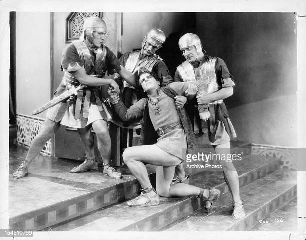 Ramon Novarro is forced up a set of stairs by guards in a scene from the film 'BenHur A Tale Of The Christ' 1925