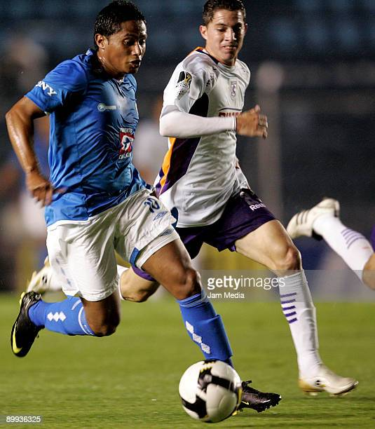 Ramon Nunez of Mexico's Cruz Azul vies for the ball with Yader Ballesteros of Costa Rica's Saprissa during their match for the Concacaf Champions...