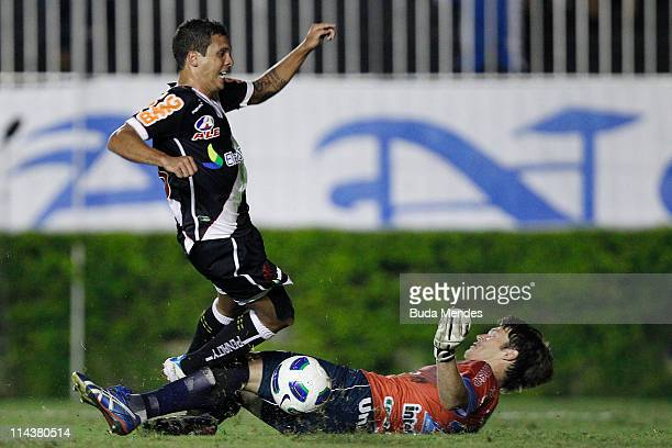 Ramon of Vasco struggles for the ball with Renan of Avai during a match as part of Brazil Cup 2011 at Sao Januario stadium on May 18 2011 in Rio de...