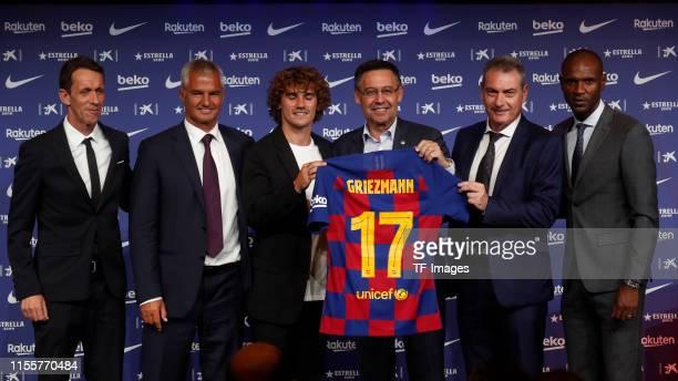 Ramon Planes of FC Barcelona president Josep Maria Bartomeu of FC Barcelona Antoine Griezmann of FC Barcelona and Eric Abidal of FC Barcelona present...